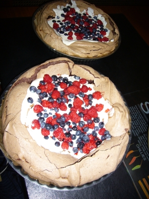 chocolate, raspberry, and blueberry pavlova
