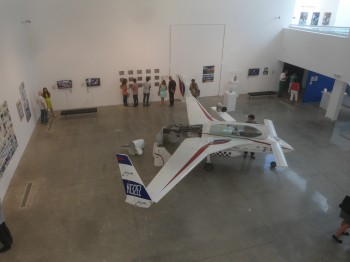 An early XCOR rocketship and several rocket engines are the central attraction of the art show.