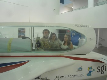 XCOR engineer Doug Weathers and his wife Anne discussing the EZ-Rocket cockpit with Lancaster artist and teacher Monica Mahoney.