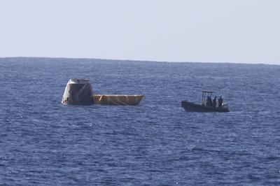 Dragon Capsule floating in Pacific